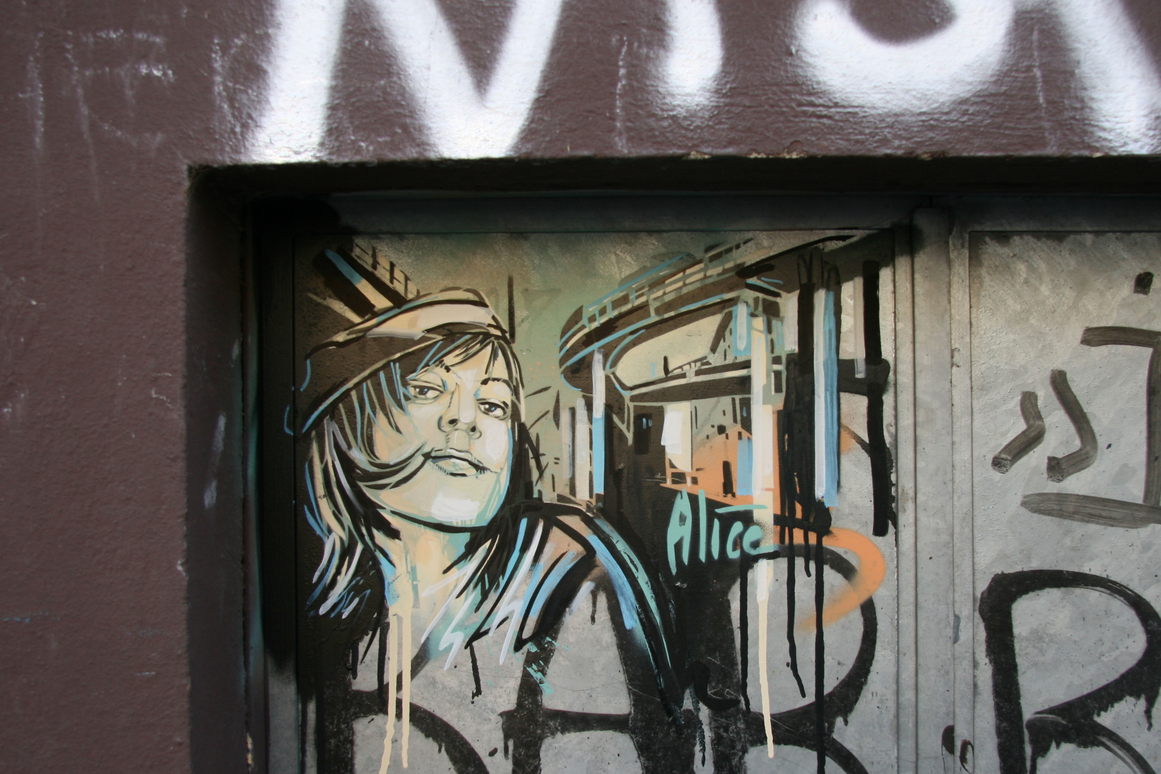 Girl with a coquettish smile: Street Art by AliCé (Alice Pasquini) in Berlin