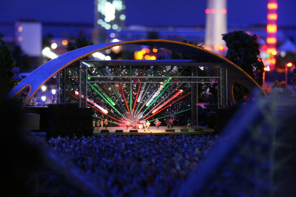 An outdoor concert at night at Loxx Miniatur Welten Berlin