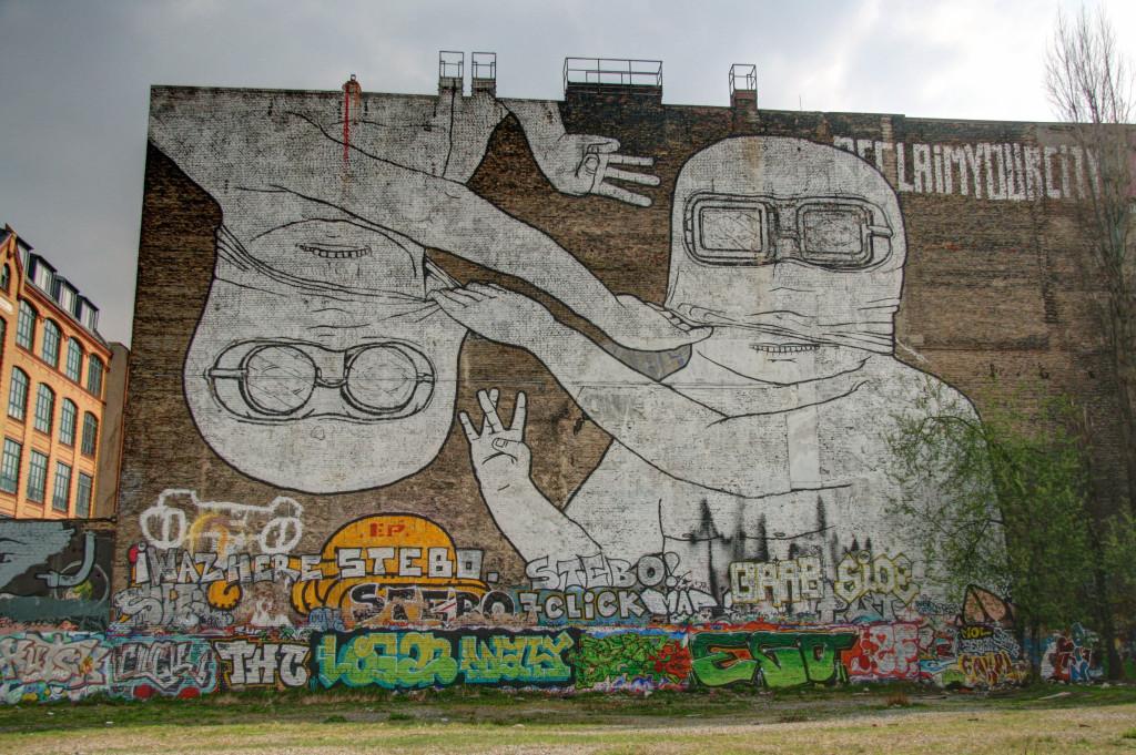 Take Off That Mask: Street Art by BLU in Berlin