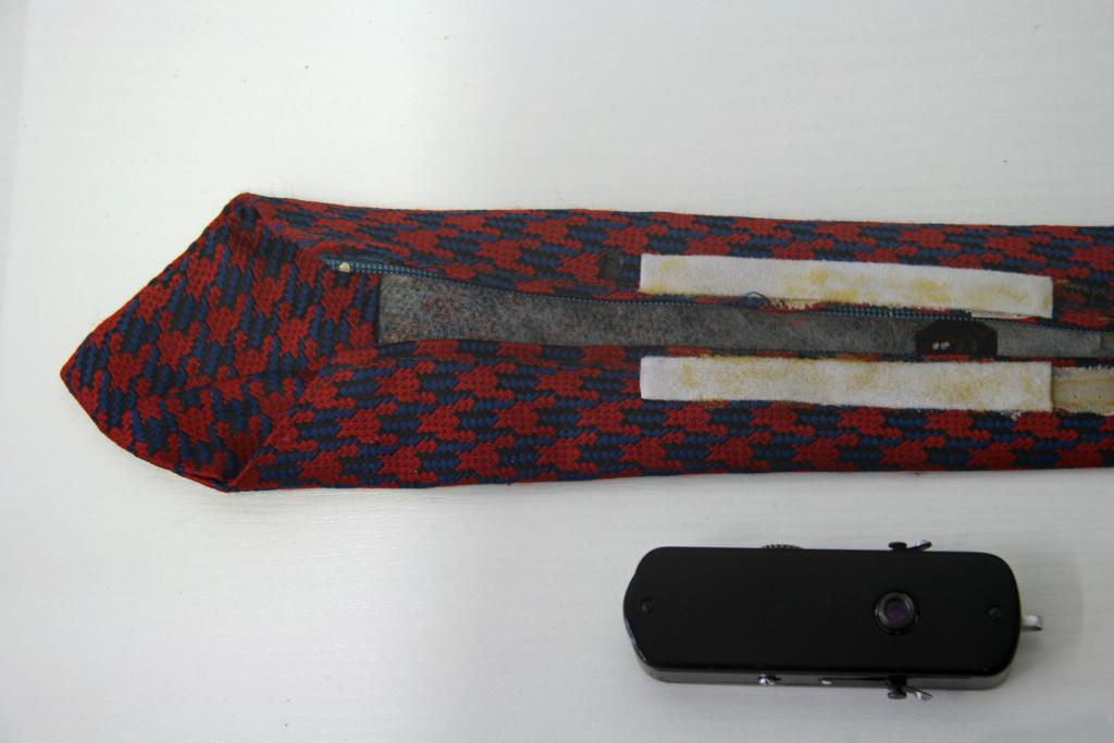 A camera hidden in a tie on display in The Stasi Museum in Berlin
