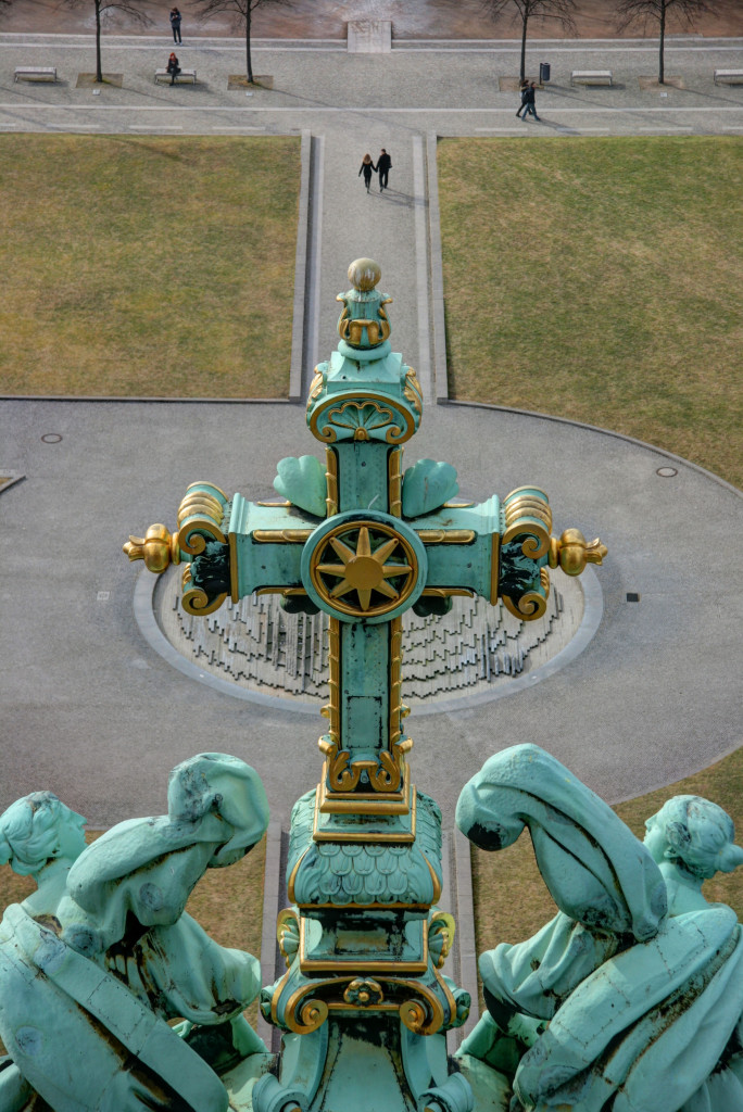 A Cross on the roof of the Berliner Dom (Berlin Cathedral) and the Lustgarten in the background