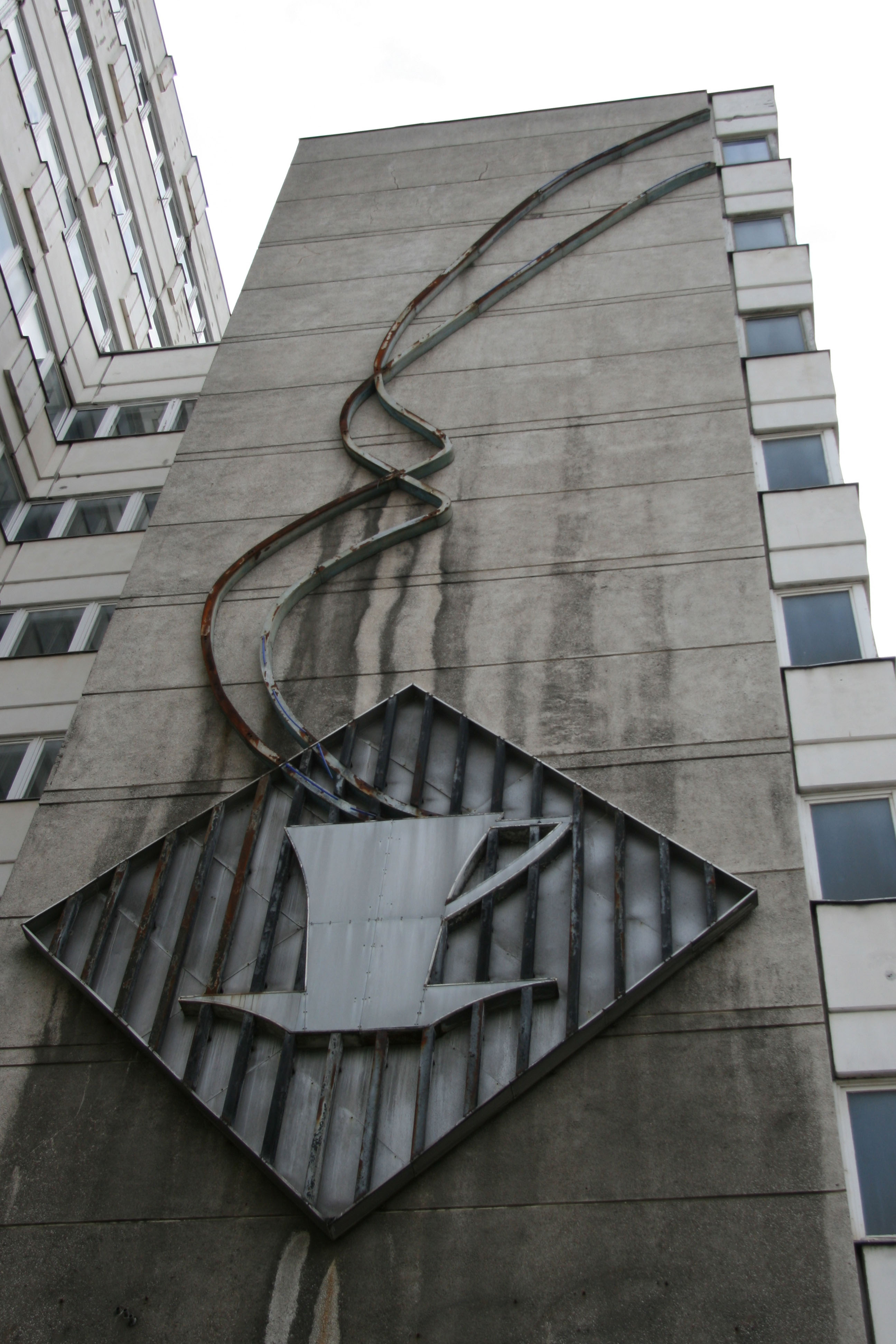 A giant Coffee Cup sign on the side of a DDR era building on Otto-Braun-Strasse in Berlin