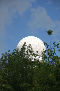 My first glimpse of the NSA Listening Station at Teufelsberg above the trees of the Grunewald Forest