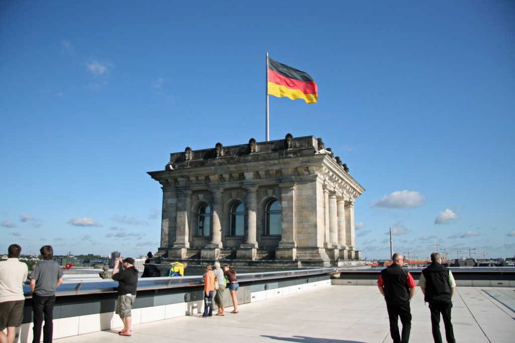 The German flag flying on the roof of the Reichstag in Berlin