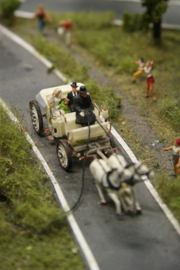 The Bride and Father of the Bride head to church in a Horse and Carriage at Loxx Miniatur Welten Berlin