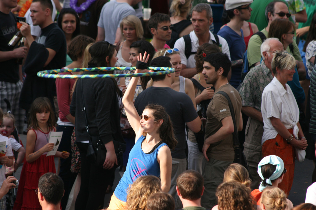 A girl twirls a Hula Hoop in the parade at Karneval der Kulturen (Carnival of Cultures) in Berlin