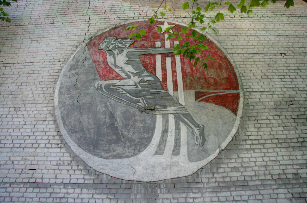 A Soviet mural on the side of a building at the Kaserne Krampnit, a former Nazi and Soviet barracks near Berlin