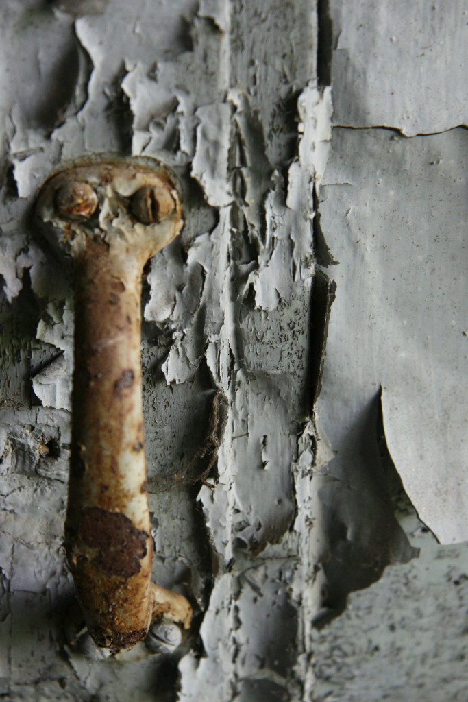 A door handle and peeling paint at the Kaserne Krampnitz - a former Nazi/Soviet Military base near Berlin