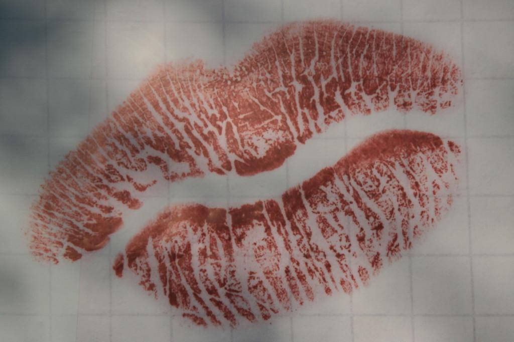 Kiss Me…Lipstick marks on a Billboard advert on Schwarzer Weg in Berlin