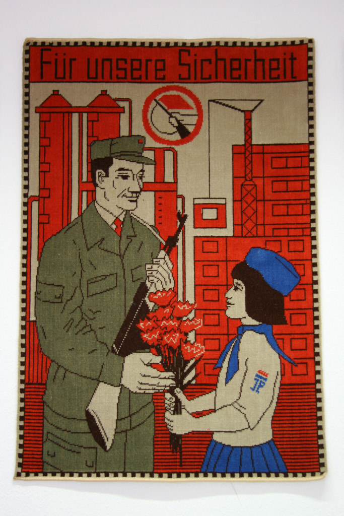 Propaganda on a wall hanging in The Stasi Museum in Berlin