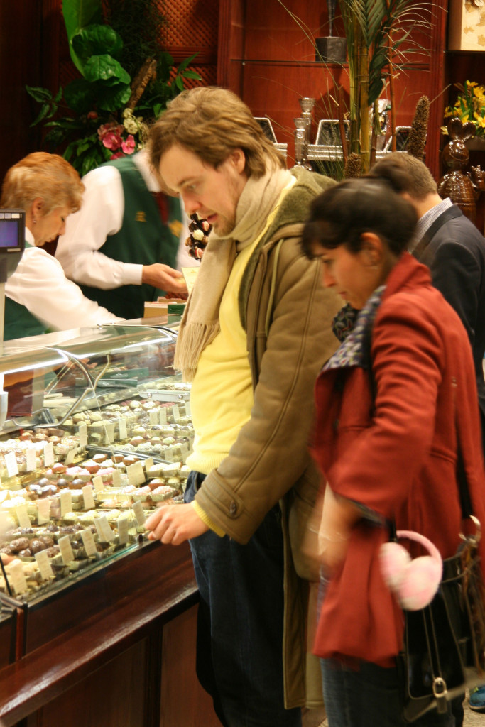 Shoppers at browsing the Truffle counter at Fassbender & Rausch Chocolatiers on the Gendarmenmarkt in Berlin