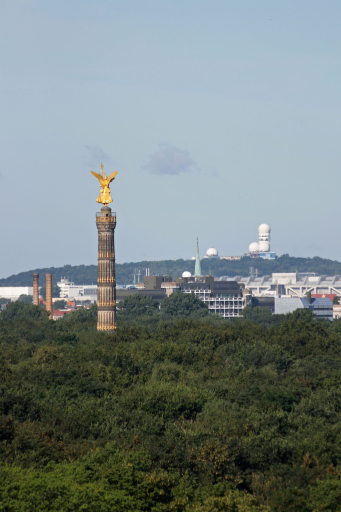 The Siegessäule rising from the Tiergarten and in the far distance the former NSA listening station at Teufelsberg in Berlin