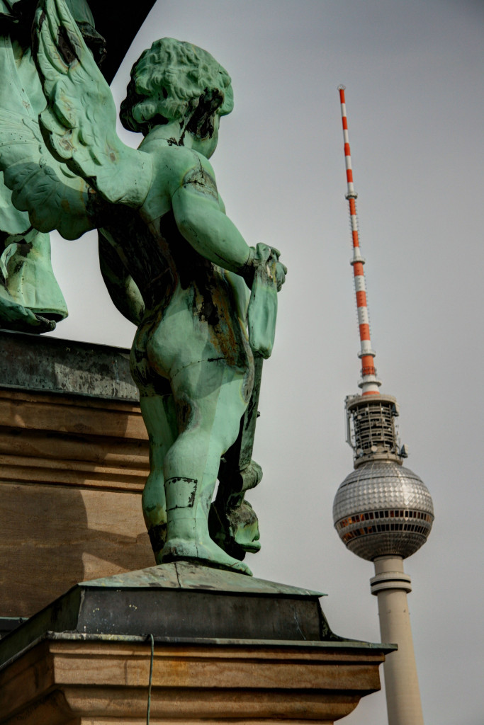 A statue on the roof of the Berliner Dom (Berlin Cathedral) appears to gaze at the Fernsehturm (TV Tower)