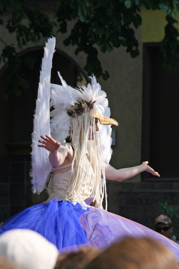 A lady in a swan costume takes part in the parade at Karneval der Kulturen (Carnival of Cultures) in Berlin