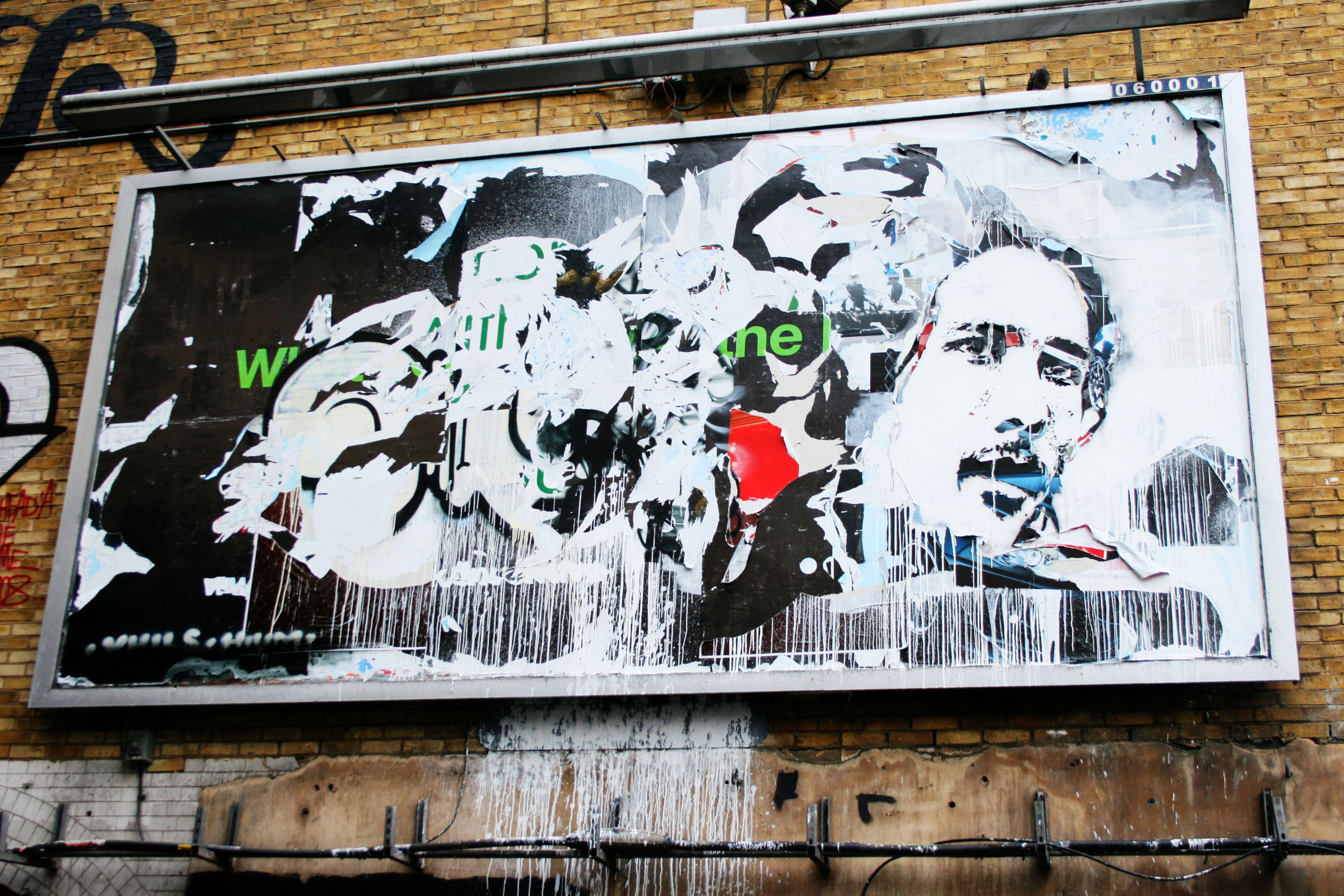 Street Art by Vhils at the entrance to the Leake Street Tunnel at Cans Festival 2 - September 2009