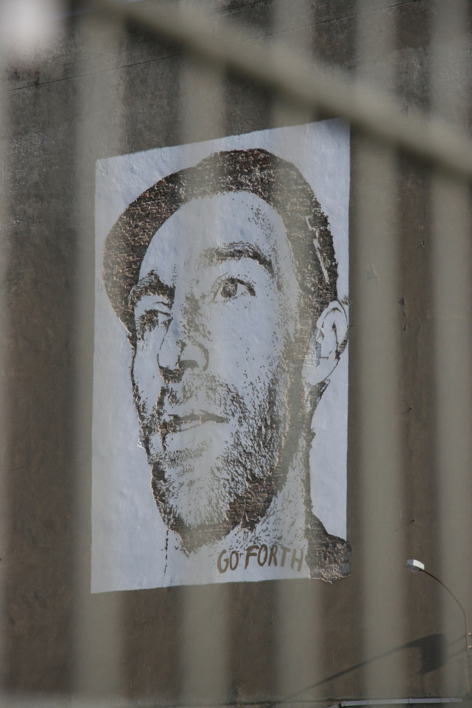 Joe Hatchiban (through a fence): Street Art by Vhils (Alexandre Farto) in Berlin for the Go Forth advertising campaign for Levi's