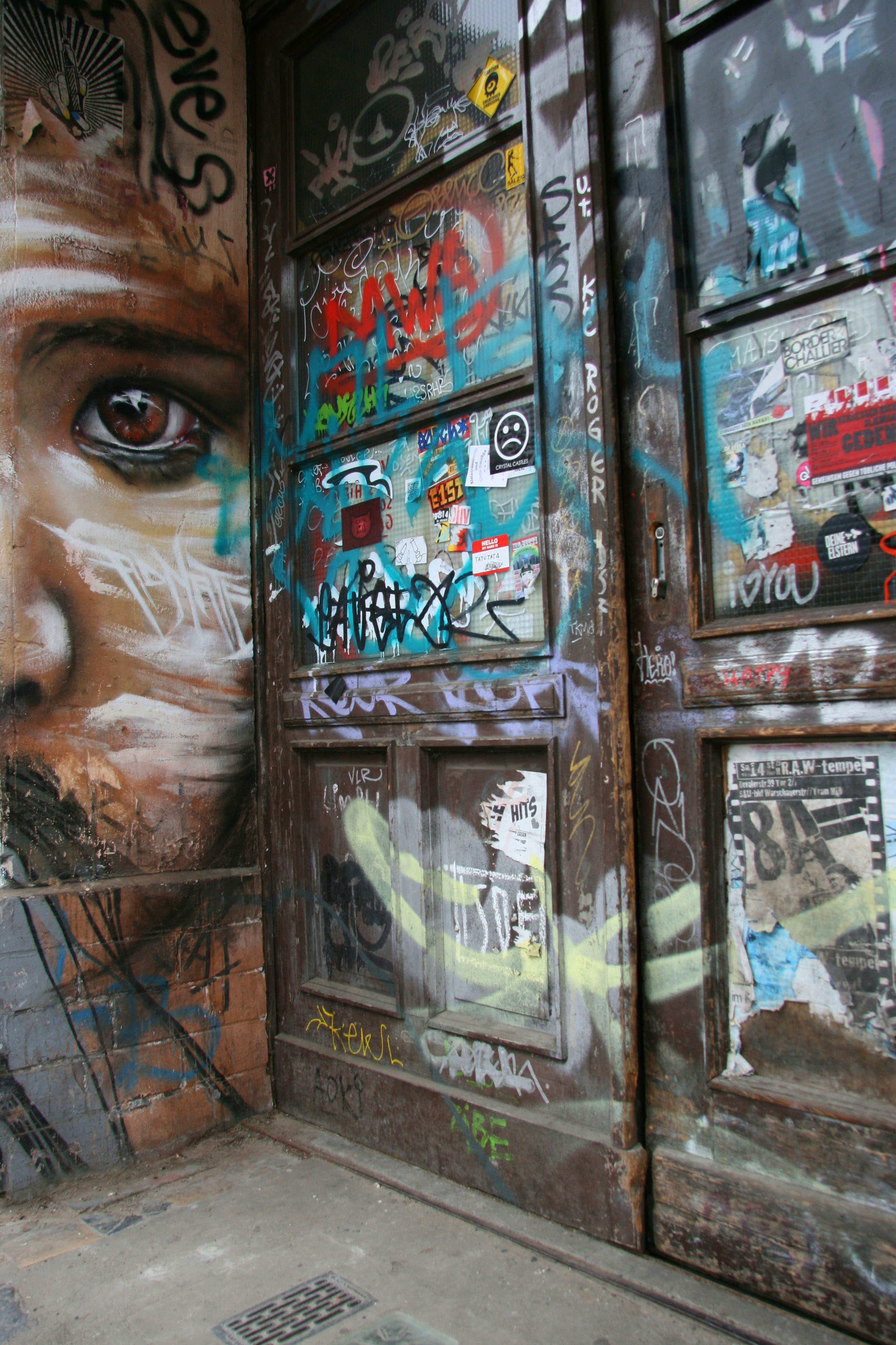 All those in favour say 'Eye': Street Art by Matt Adnate in a Berlin doorway
