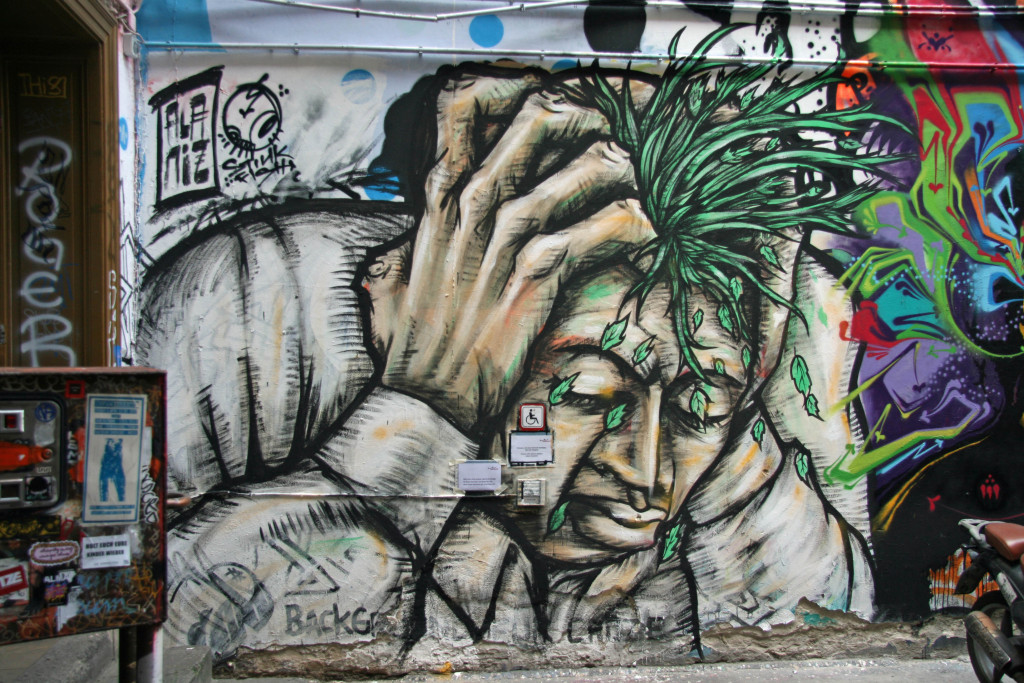 Head in Hands: Street Art by ALANIZ in Berlin