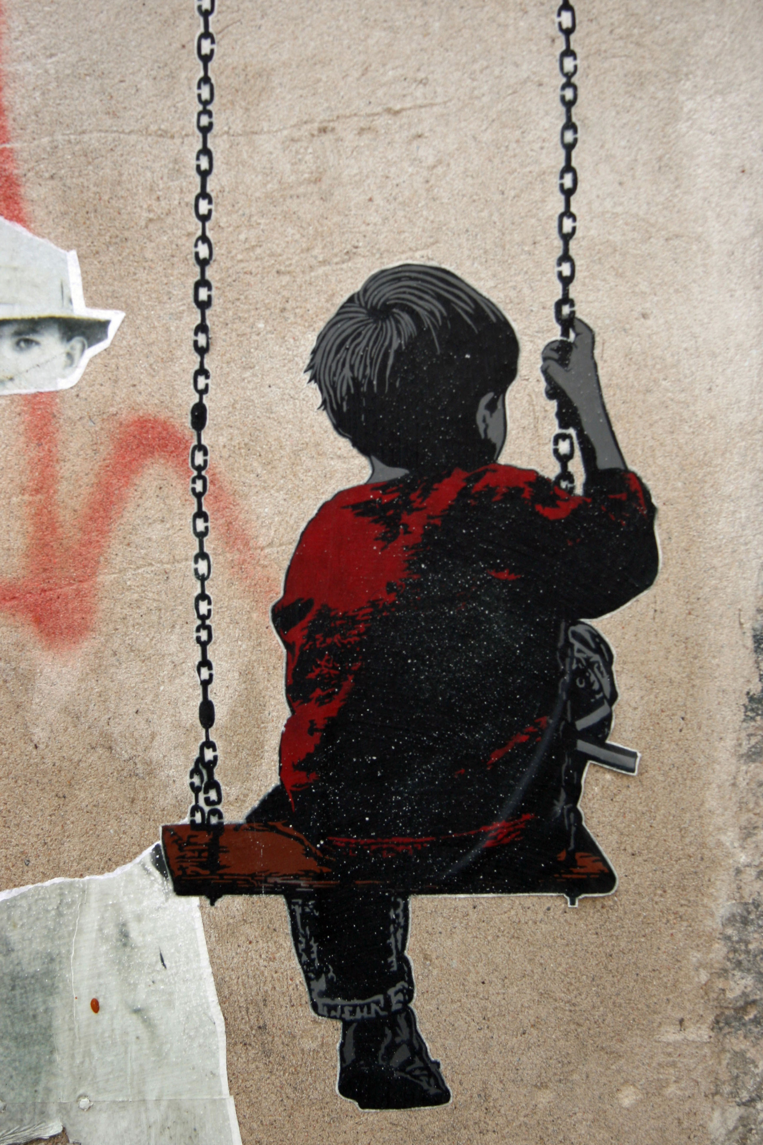 Boy On A Swing: Street Art by ALIAS in Berlin