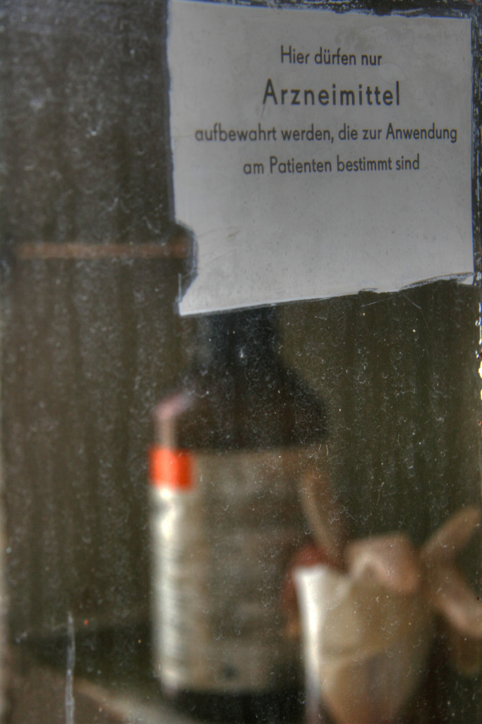 A medicine cabinet at Sanatorium E near Potsdam - the sign reads 'Only drugs intended for use on patients should be kept here'