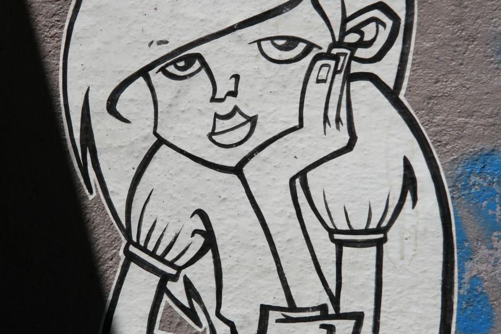 Bored Girl: Street Art by Unknown Artist in Berlin