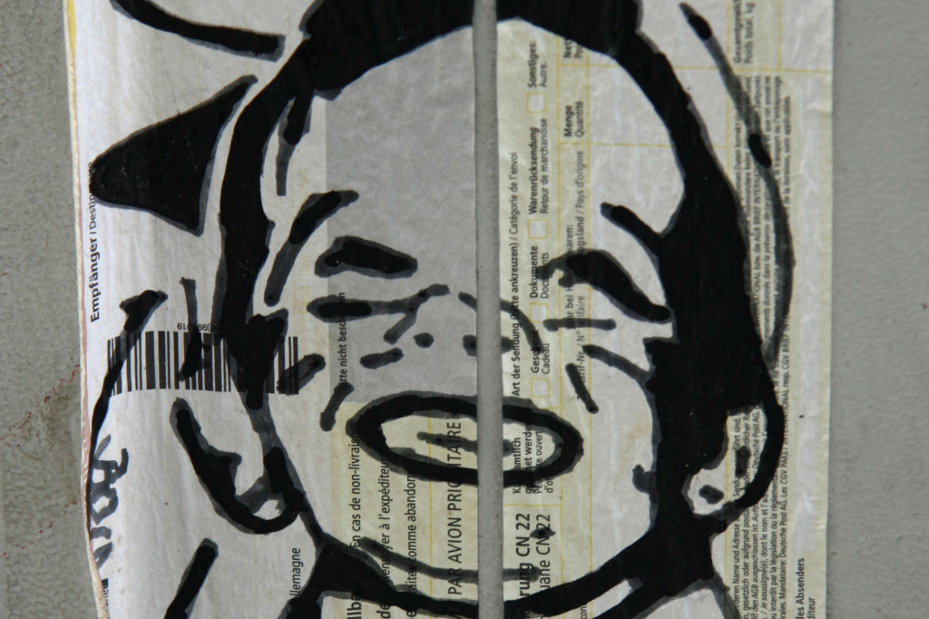 Boy on Postal Label: Street Art by Unknown Artist in Berlin