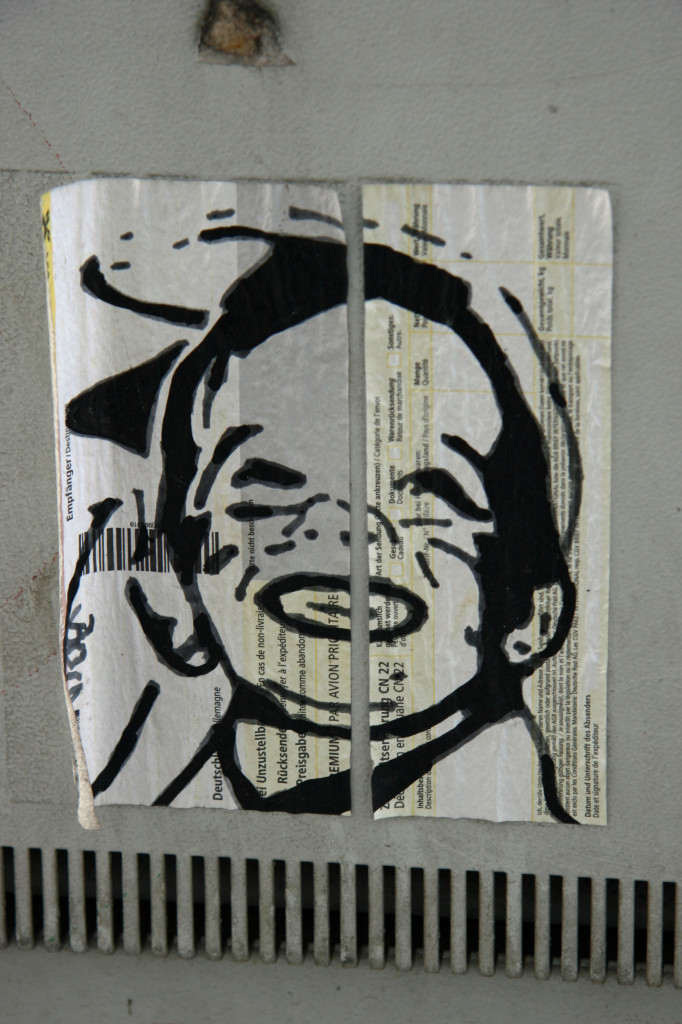 Boy on Postal Label: Street Art by Unknown Artist in Berlin