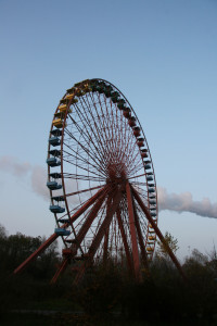 Cloud Crosses the Ferris Wheel (Riesenrad) at Spreepark Plänterwald, an abandoned Theme Park in Berlin