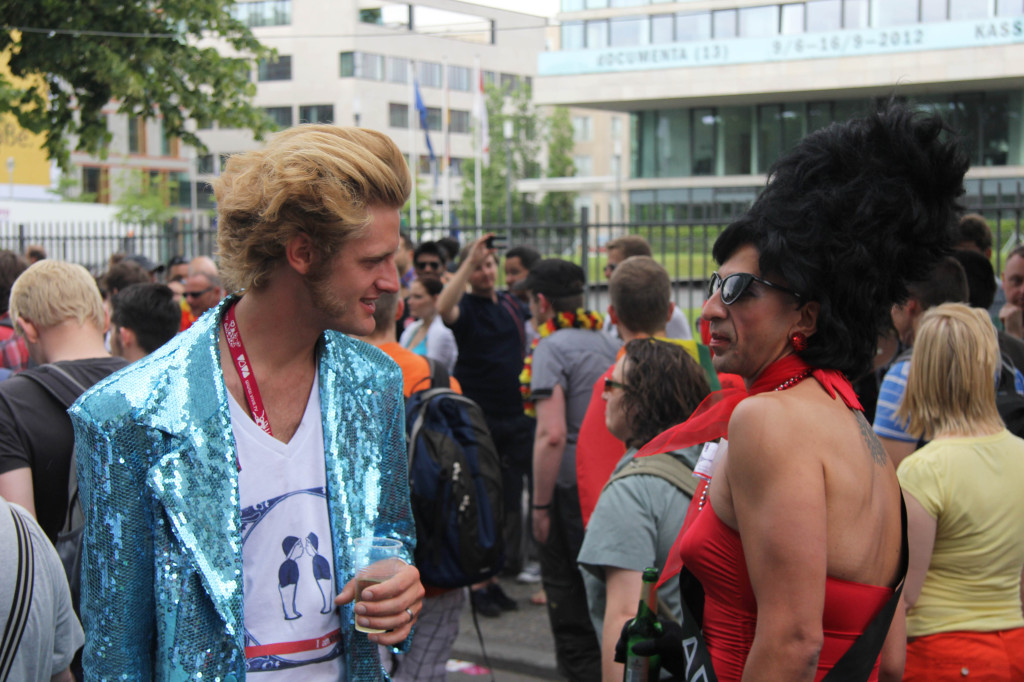 Flirting: Two revellers at the Christopher Street Day (CSD) Parade in Berlin flirt with each other as they walk with the procession