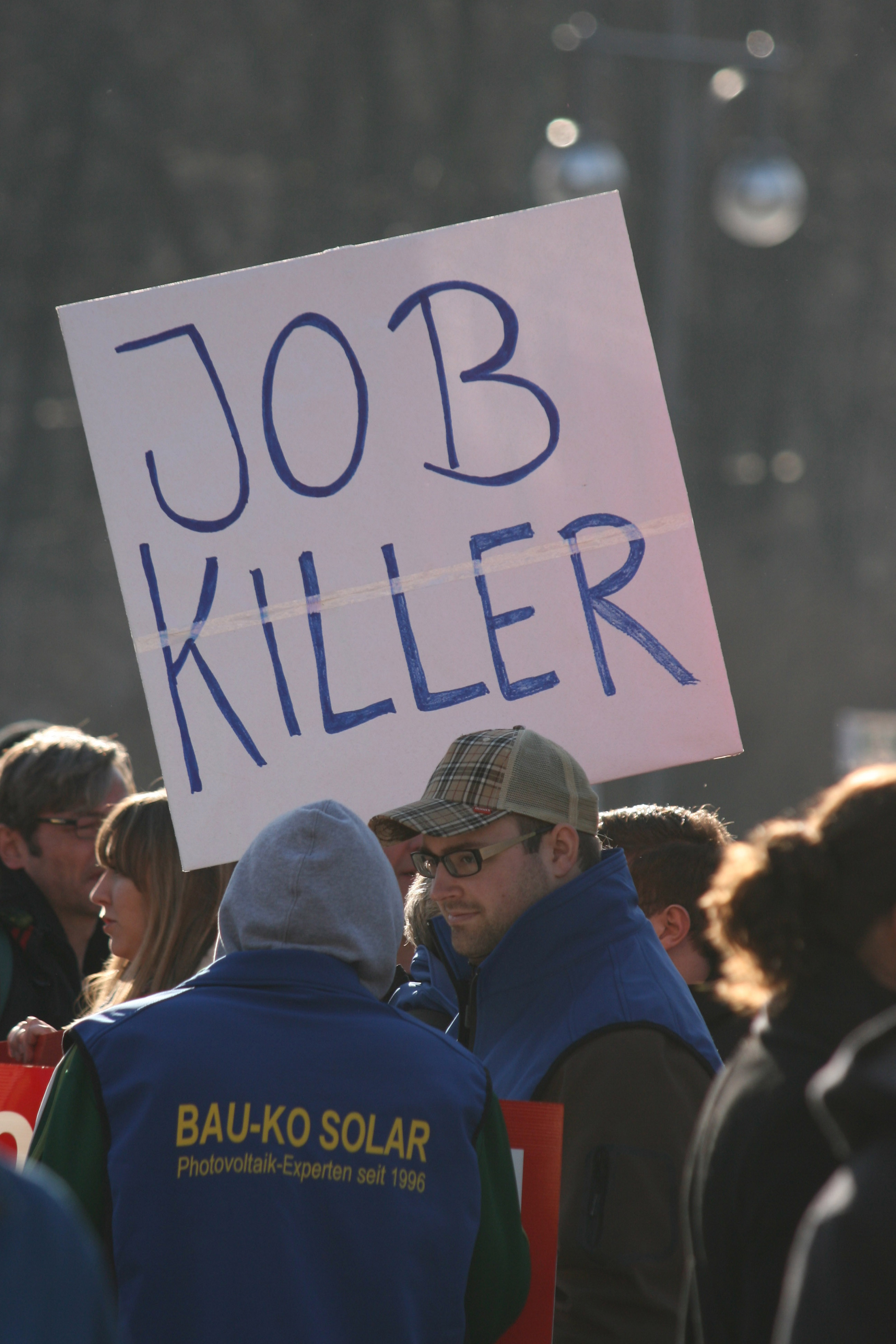 Job Killer - Protesters near the Brandenburg Gate (Brandenburger Tor) in Berlin during a demonstration over cuts in Solar Power subsidies