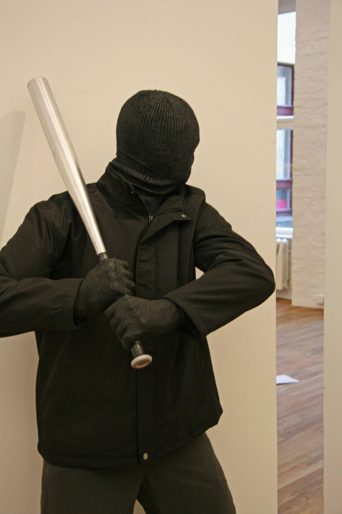 A thug with a baseball bat lies in wait - a sculpture by Mark Jenkins, part of the Glazed Paradise exhibition at Gestalten in Berlin