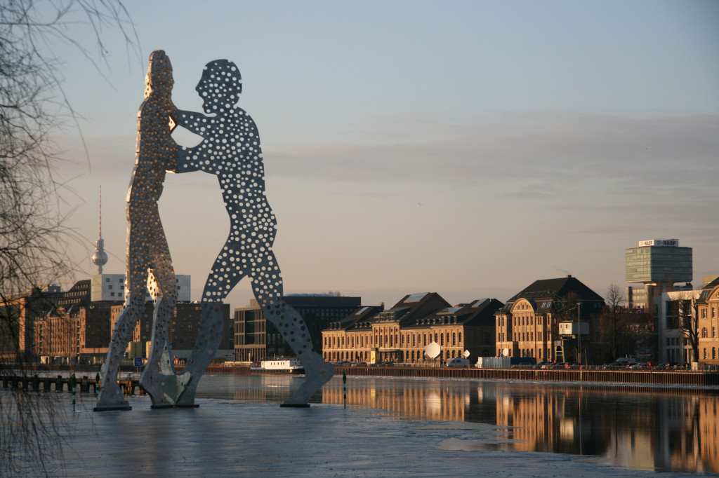 The Molecule Man sculpture by Jonathan Borofsky on a partially frozen Spree and The Fernsehturm in a Berlin Winter