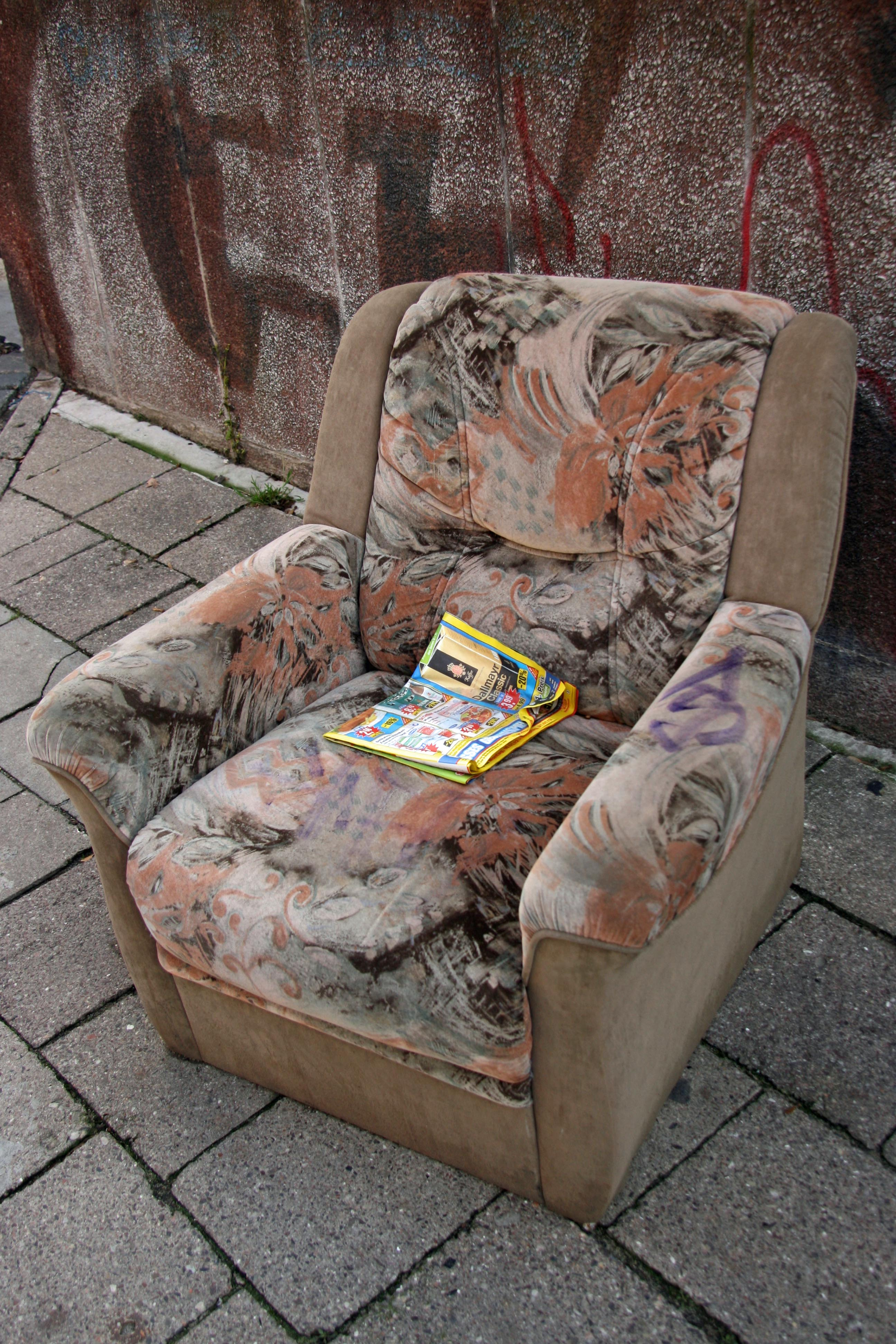 An old armchair left on the street in Prenzlauer Berg in Berlin