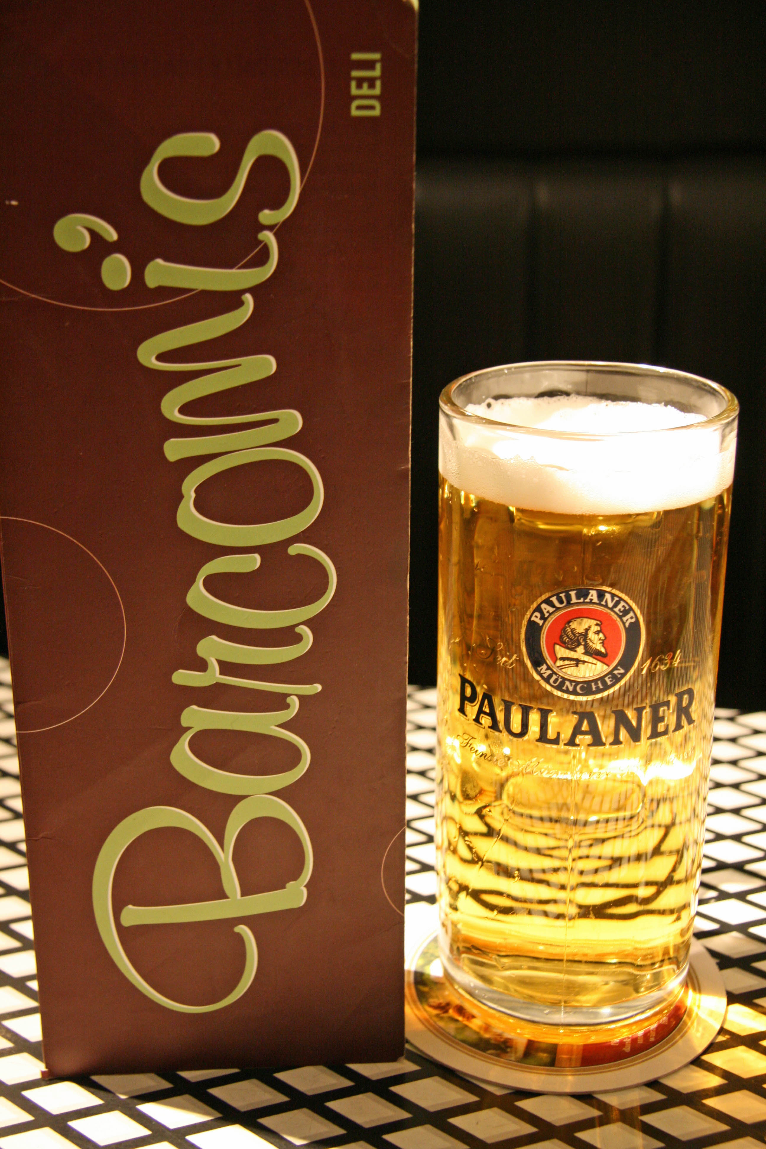 Paulaner Münchner Hell & Menu at Barcomi's Deli in Berlin