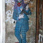 Clown With a Rifle Guitar: Street Art by Primo in Berlin
