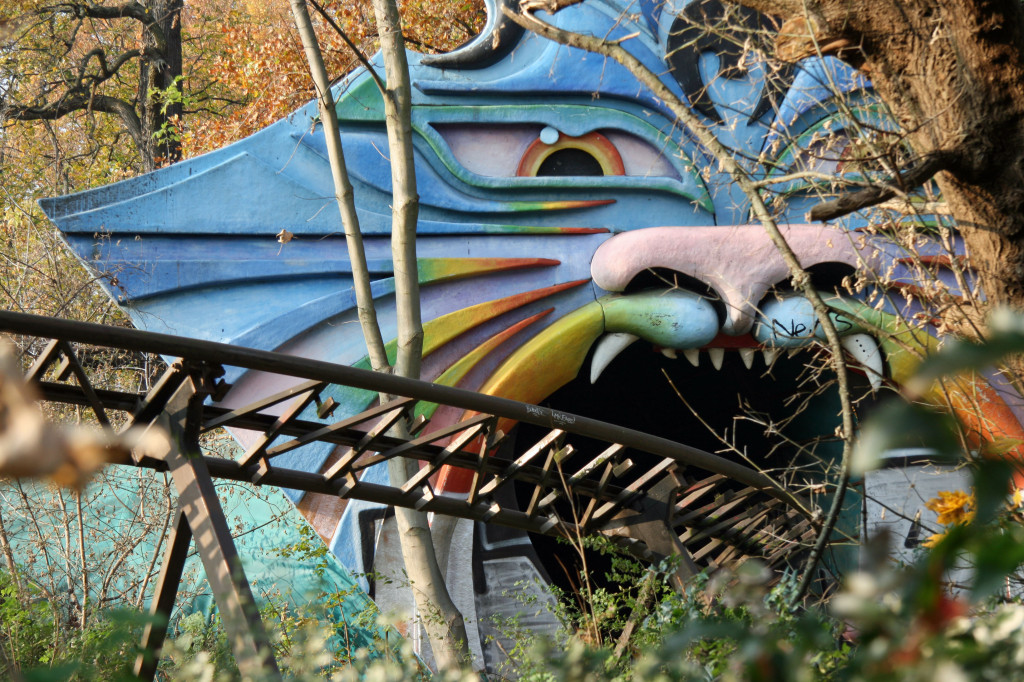 The track of the Spreeblitz ride enters a psychedelic tiger's mouth at Spreepark Plänterwald, an abandoned Theme Park in Berlin