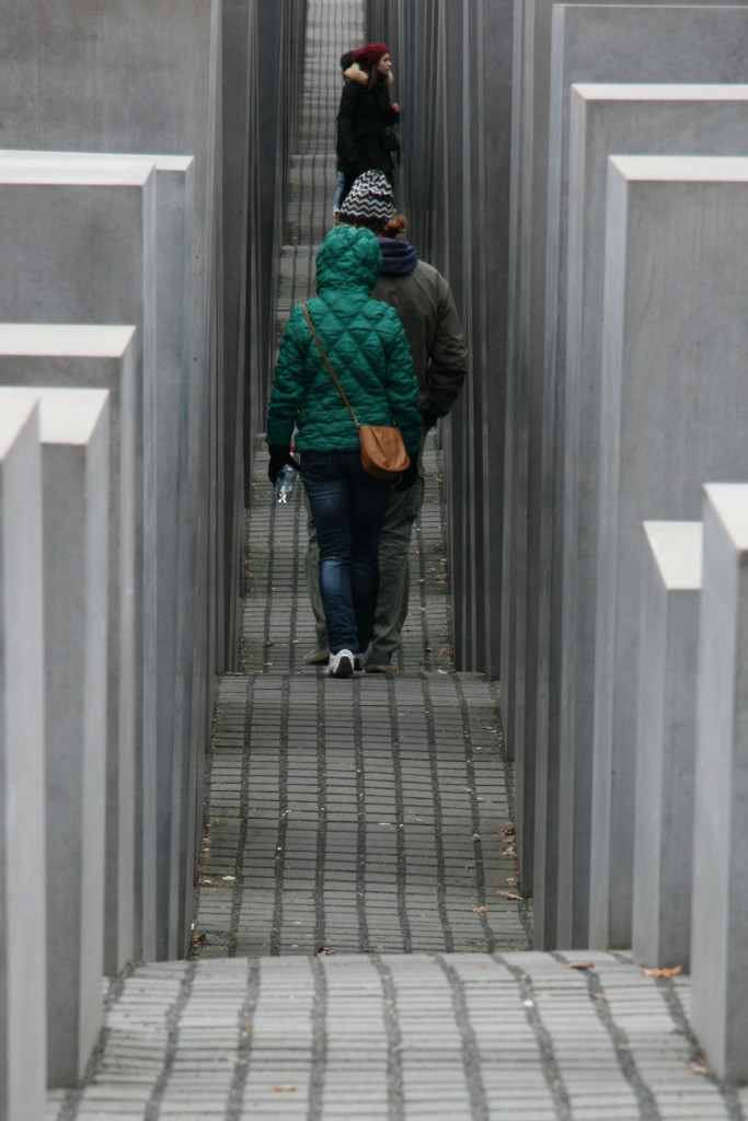 Tourists Walk Through The Field of Stelae at Memorial to the Murdered Jews of Europe (Holocaust Memorial) in Berlin