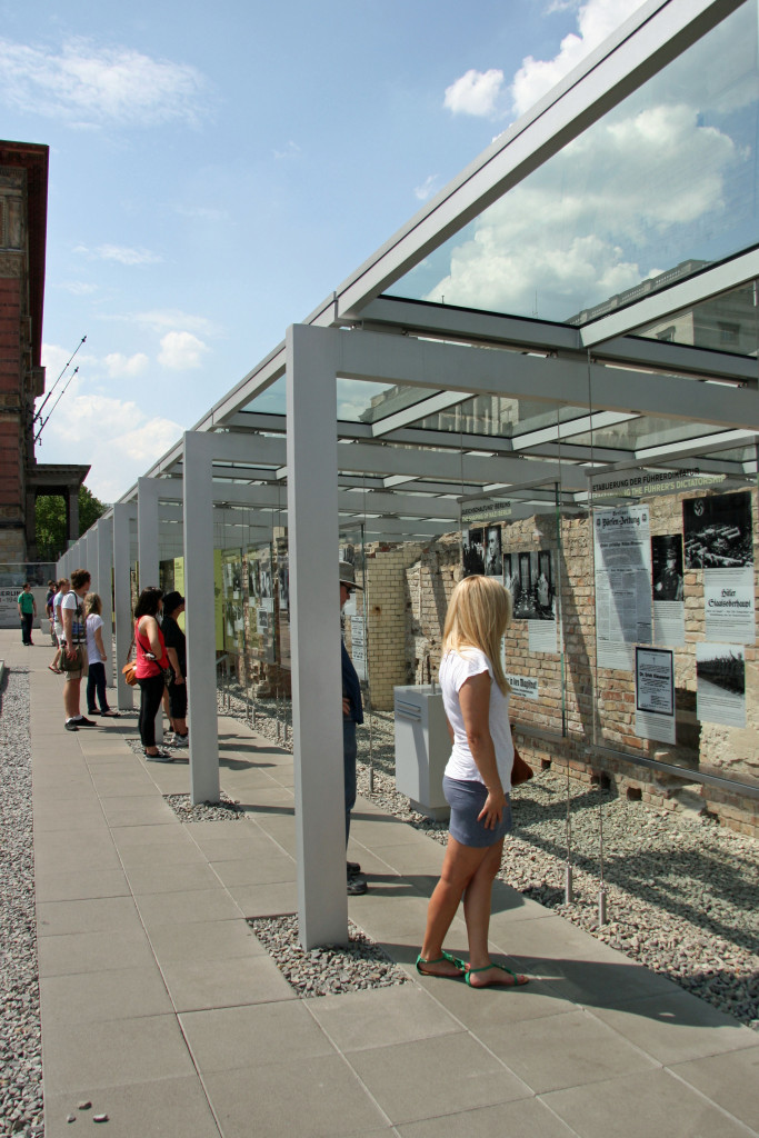 Visitors take in the outdoor exhibition (Exhibition Trench) at Topographie des Terrors (Topography of Terror) in Berlin