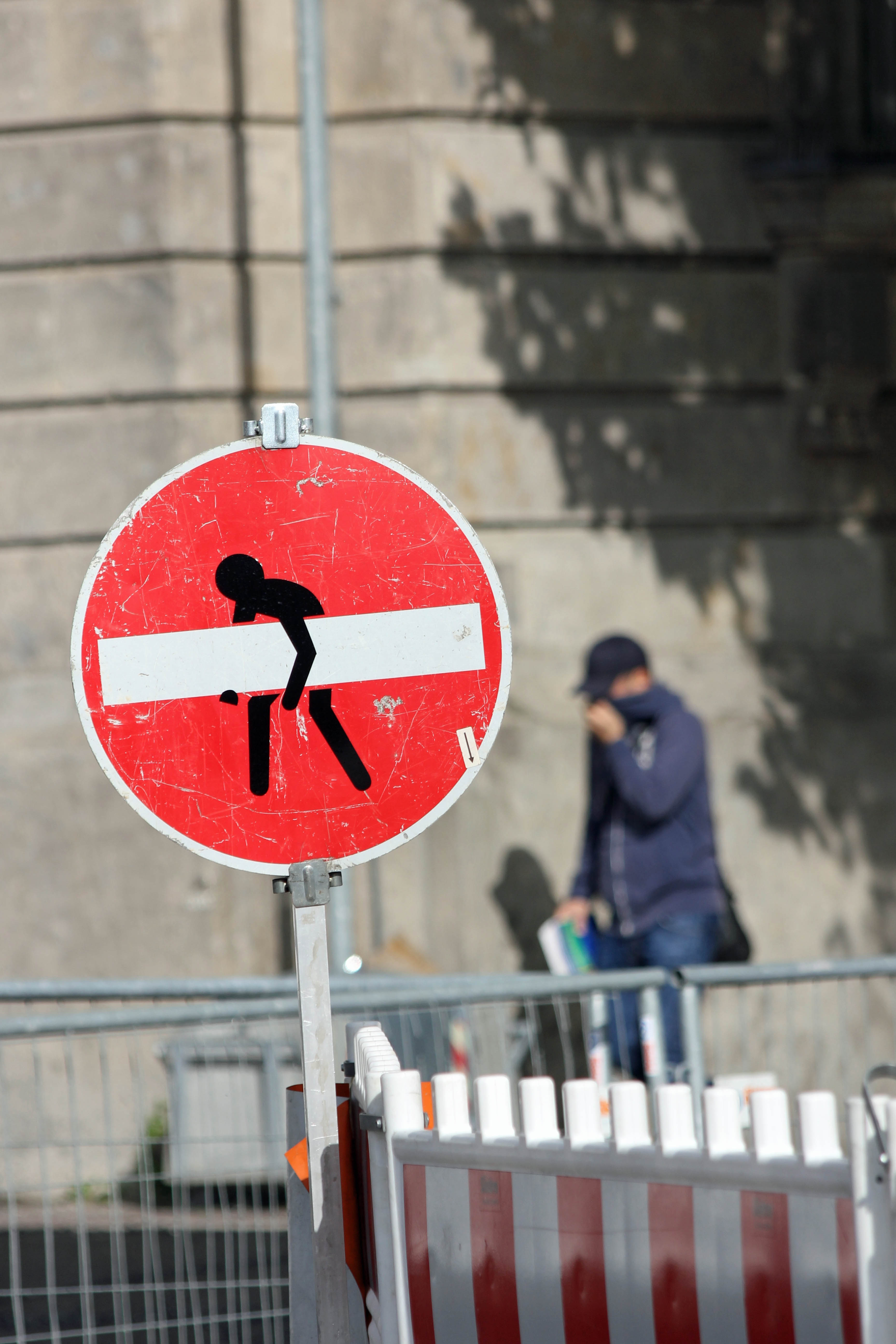 Stop…Carry On - Street Art by CLET (Clet Abraham) on a No Entry street sign in Berlin