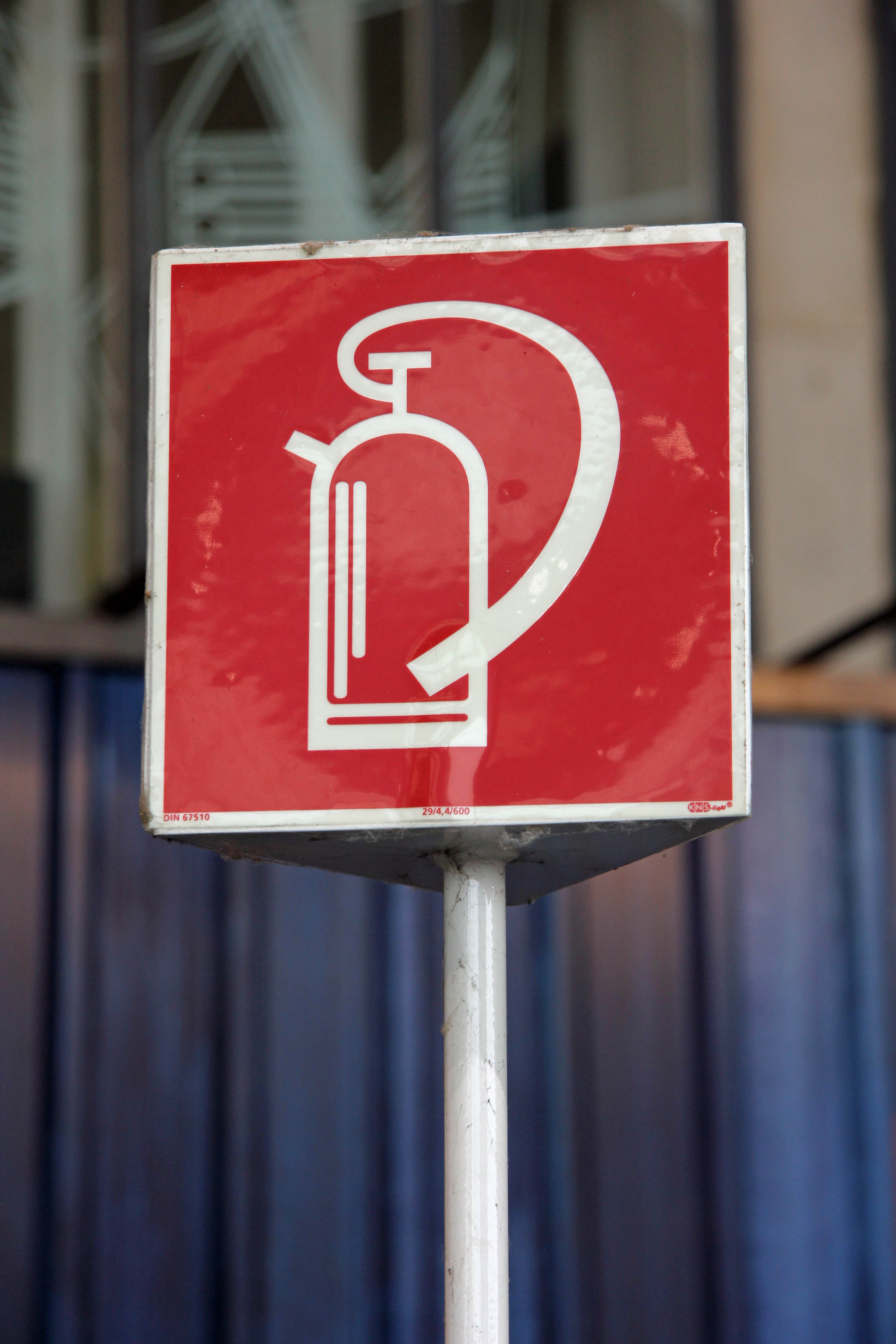 A Fire Extinguisher sign in the hangar space at Tempelhof Airport in Berlin