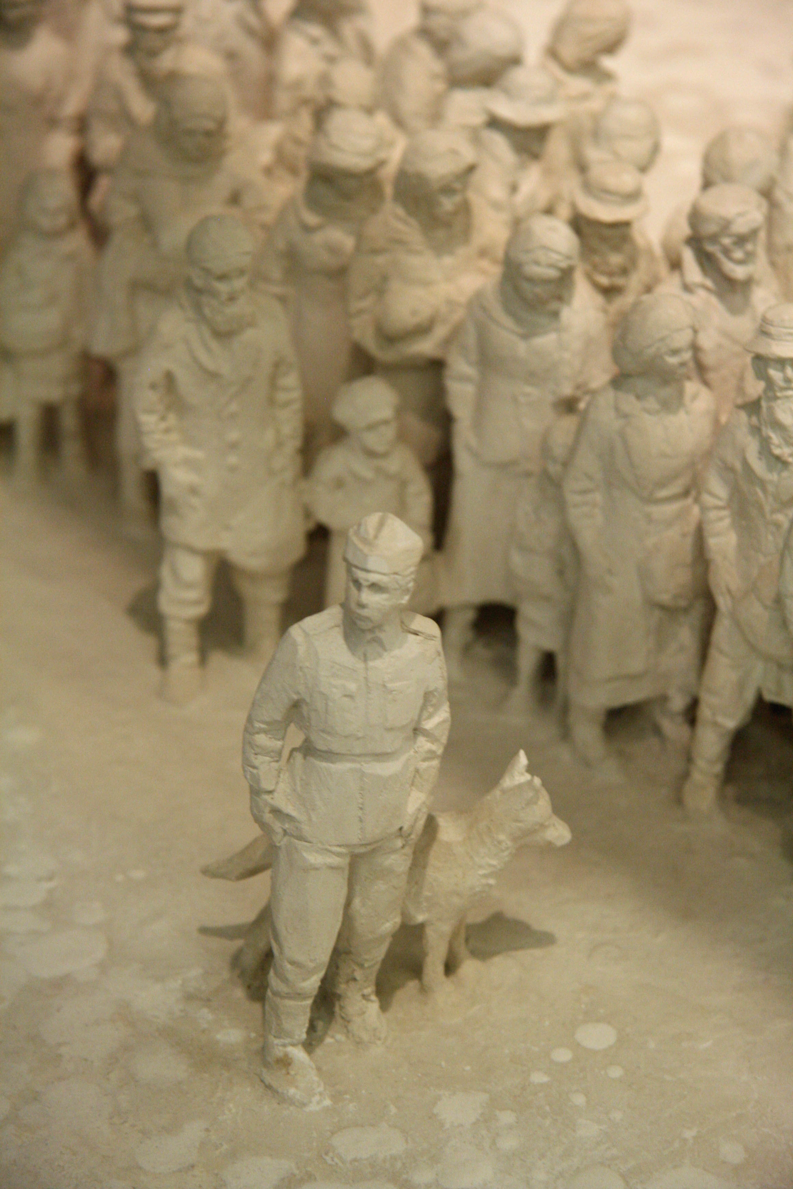A guard with a dog and prisoners in a model of Auschwitz by Polish sculptor Mieczyslaw Stobierski at the Deutsches Historisches Museum (German Historical Museum) in Berlin