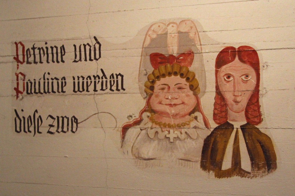 Petrine und Pauline artwork on the wall of an air raid shelter in the basement of Tempelhof Airport in Berlin