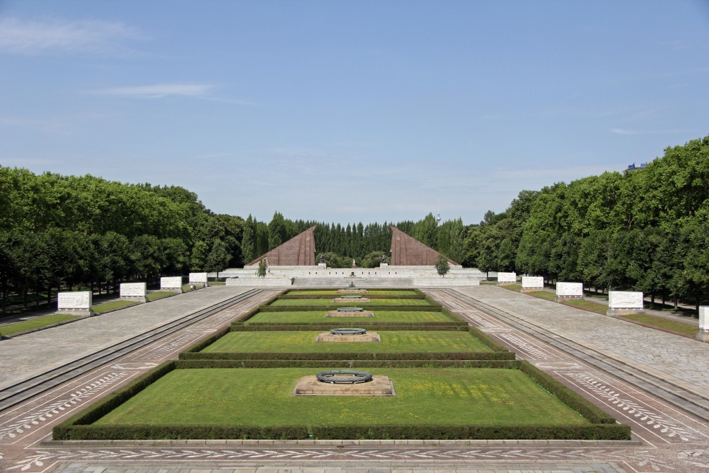 The view from the statue at the Soviet War Memorial in Teptower Park in Berlin over the mass graves towards the red granite gateway