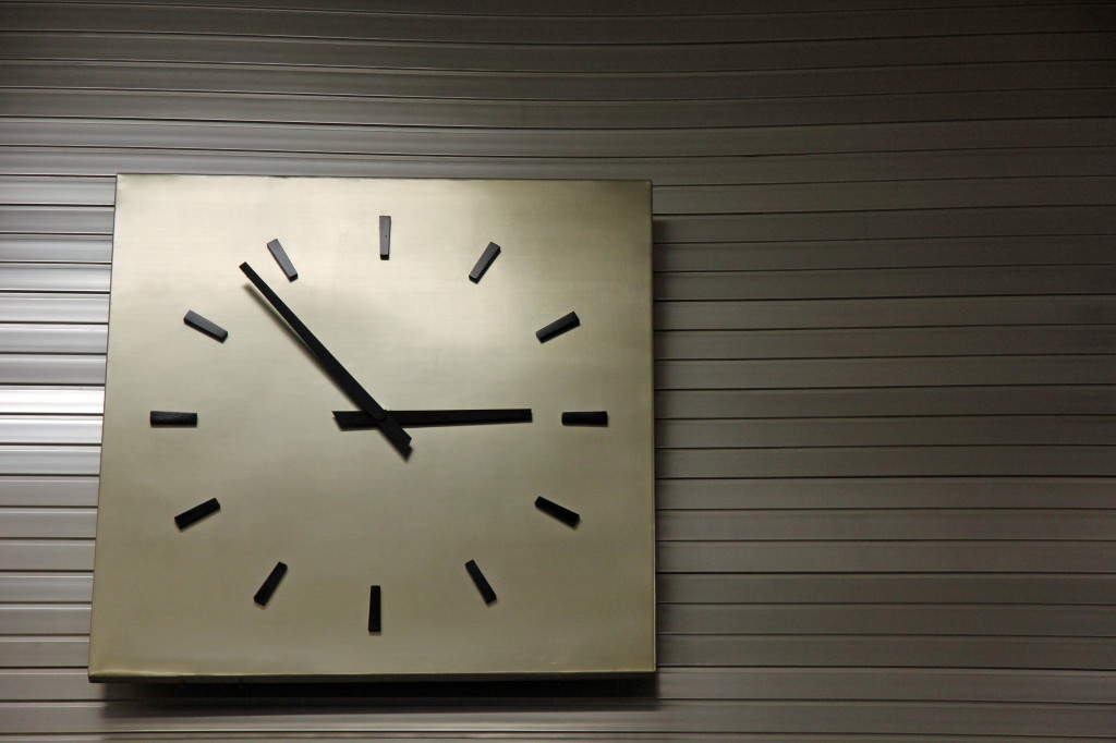 A clock on the wall of the Main Hall at Tempelhof Airport in Berlin