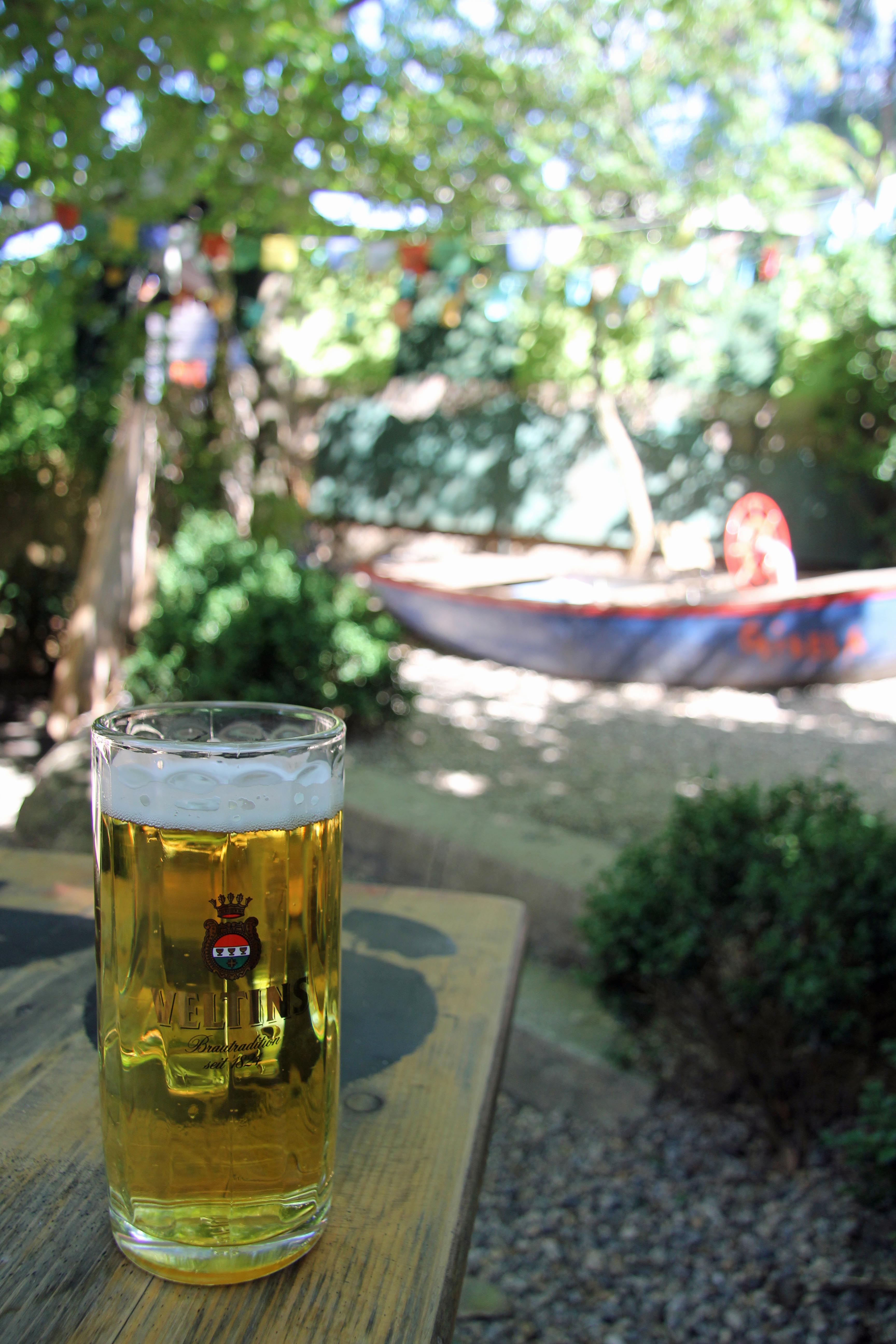 Veltins at Schleusenkrug and the pirate ship in the background in the Tiergarten in Berlin