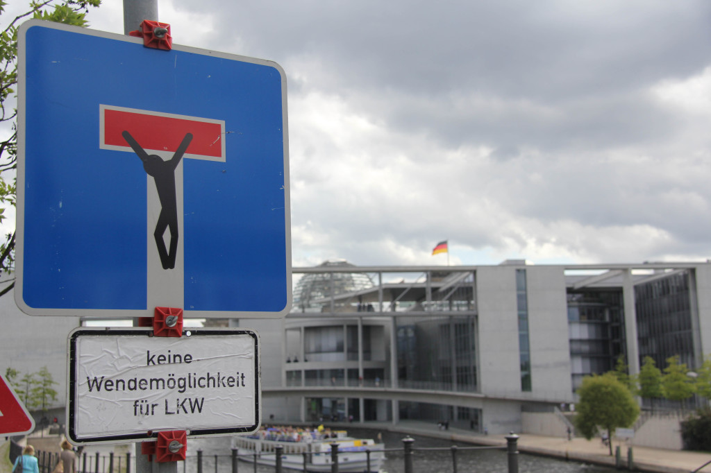 Dead End (Crucifixion): A street sign intervention - the clever street (sign) art of CLET in Berlin