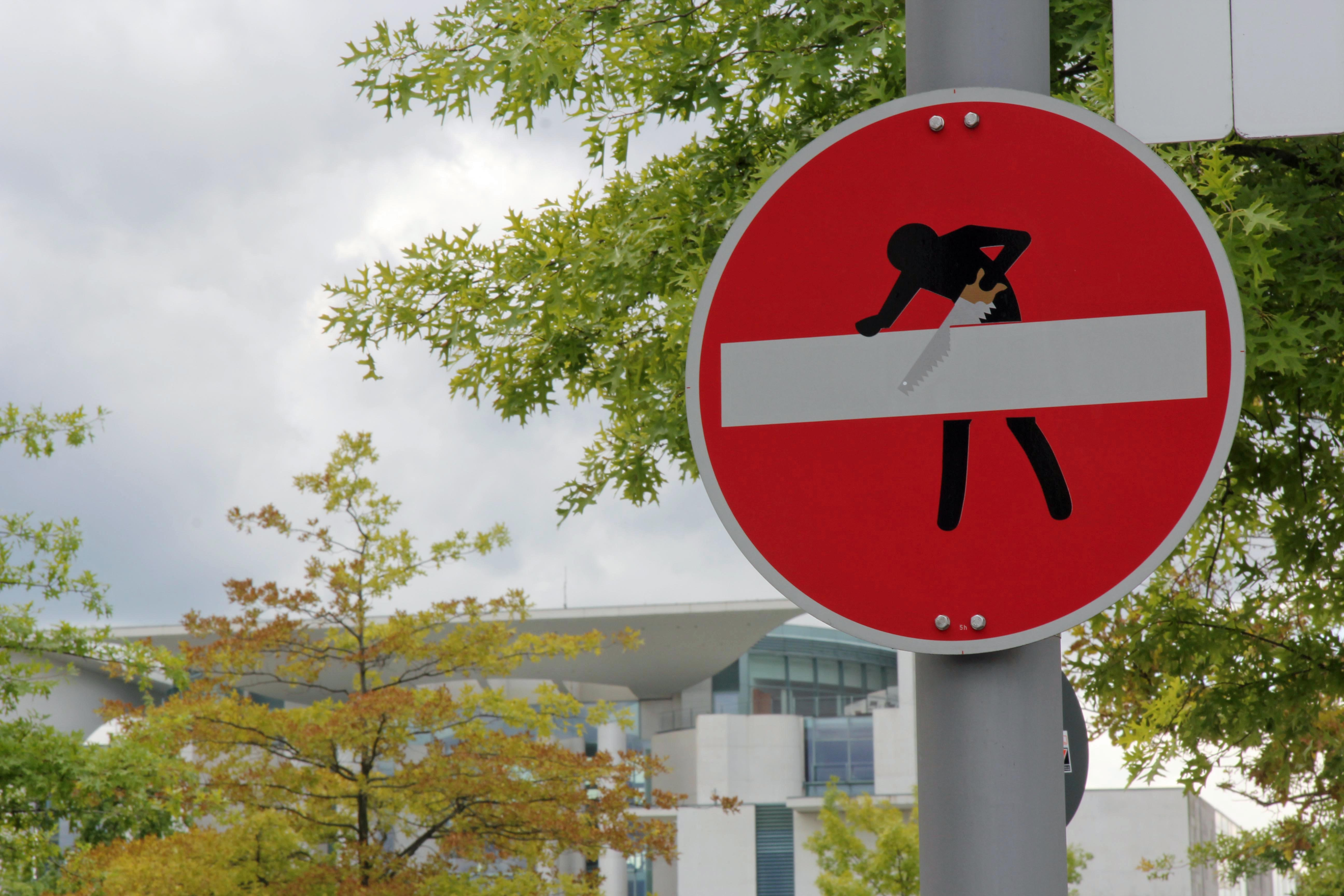 Sawing: A street sign intervention - the clever street (sign) art of CLET in Berlin