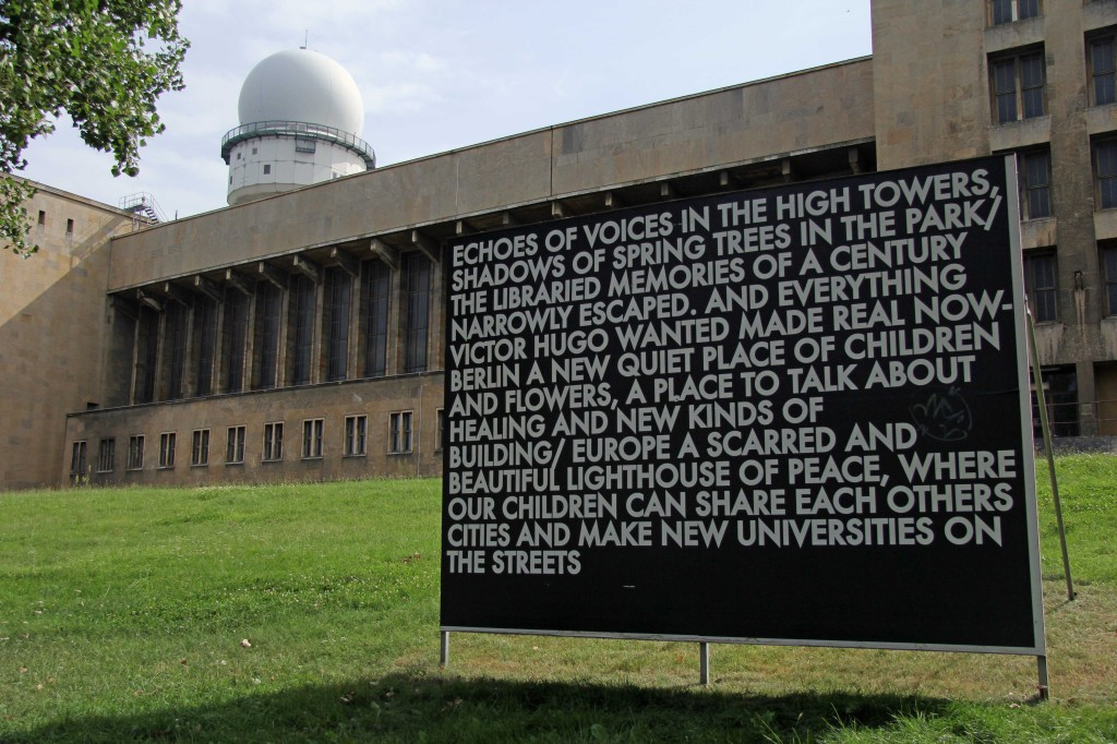 Echoes of voices in the high towers – a billboard installation by Robert Montgomery at the former Tempelhof Airport in Berlin