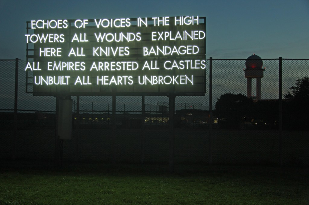 Echoes of voices in the high towers – a light installation by Robert Montgomery at the former Tempelhof Airport in Berlin