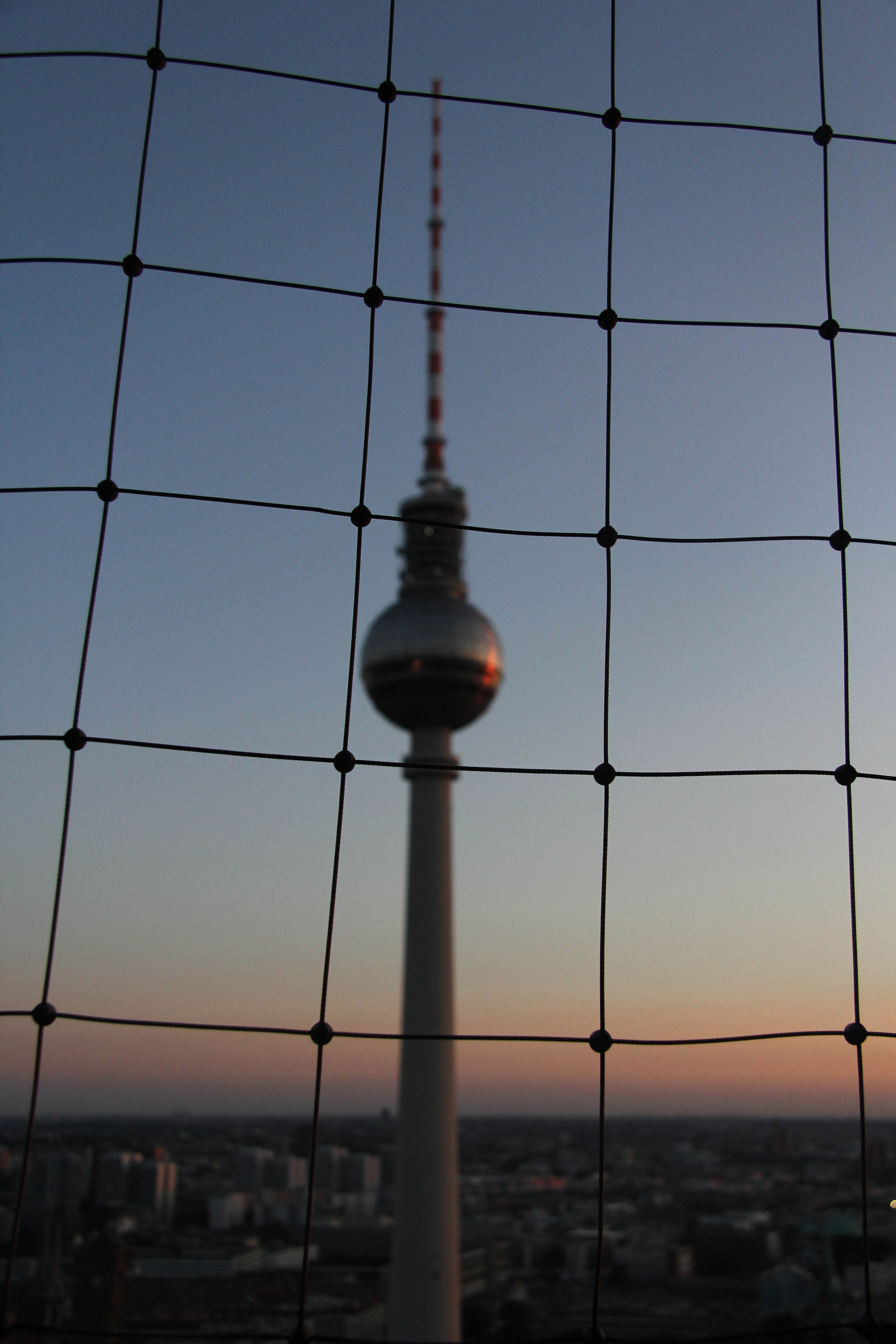 Fernsehturm through netting: The view from the Sun Terrace of the Park Inn on Alexanderplatz
